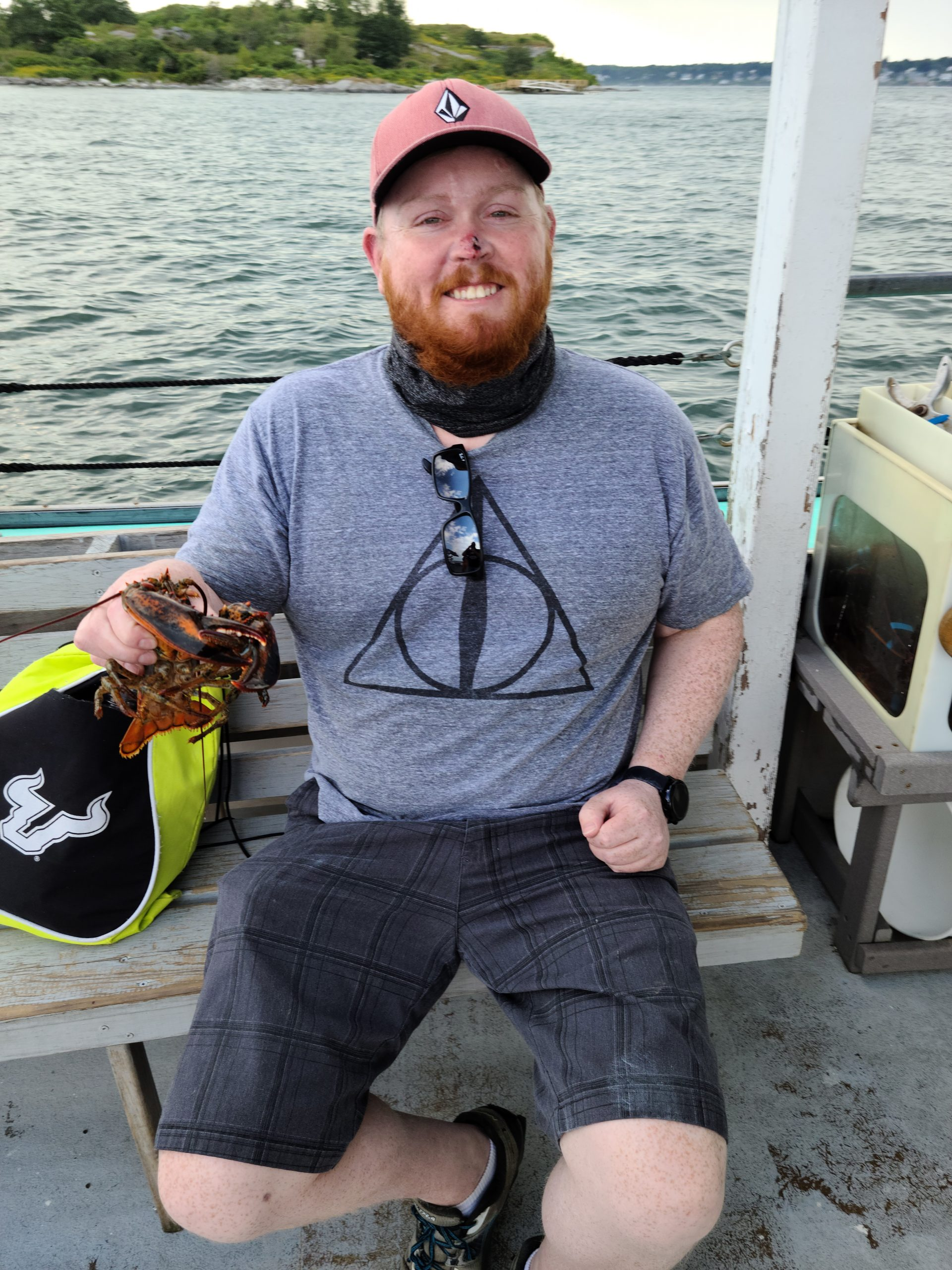 Holding a Lobster we Caught